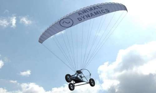 An autonomous paragliding drone gliding in the air.